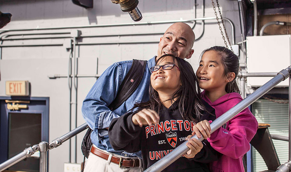 family looking at the sky in the observatory