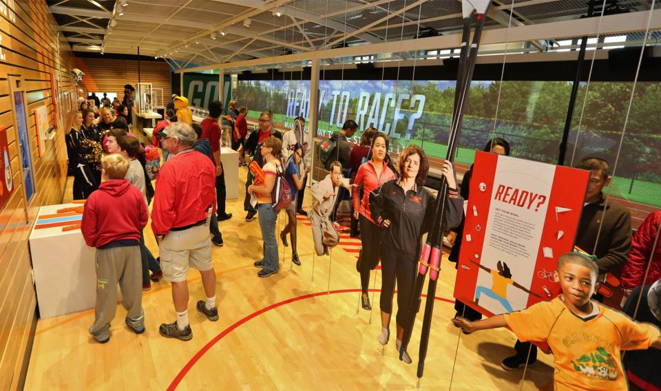Families exploring the Sports Zone Exhibit at its Grand Opening