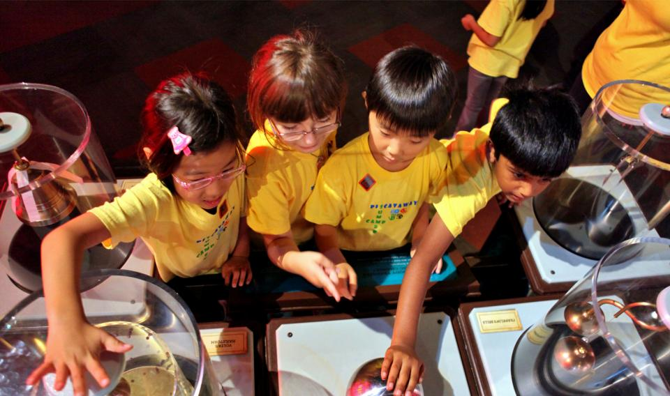 Children interacting with the Electricity exhibit at The Franklin Institute