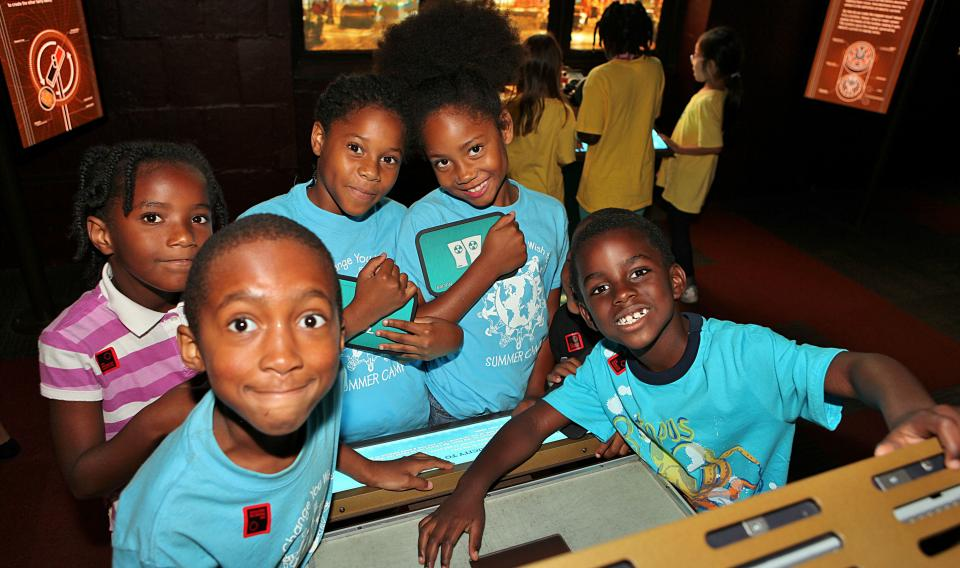 A group of children on a field trip at the electricity exhibit at The Franklin Institute