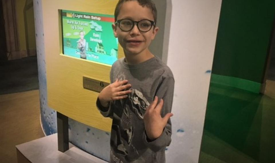 Photo of child in an exhibit at The Franklin Institute