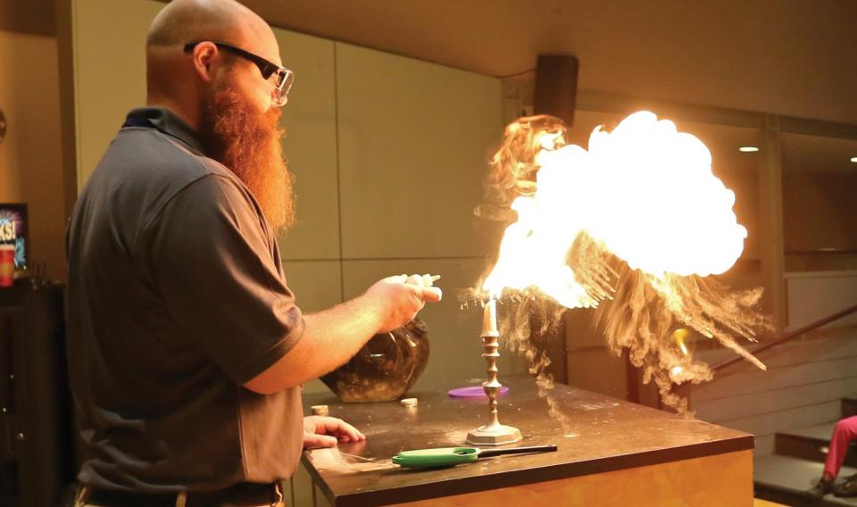 A live presenter, Buddy, demonstrates the science of fireworks.