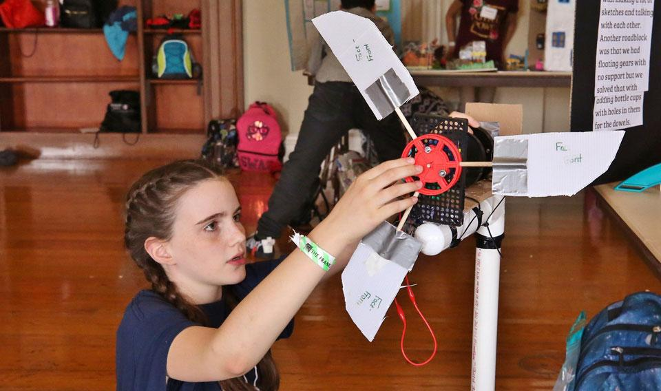 Girl working on science project