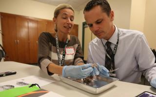 Two educators performing a dissection during a Franklin Institute workshop.