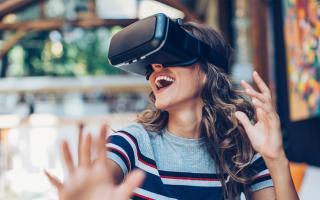 Woman experiencing virtual reality through a headset