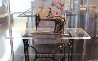 Antique sewing machine in the Amazing Machine exhibit at The Franklin Institute.