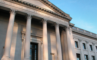 Image of the front facade of the main entrance of the Franklin Institute in day light