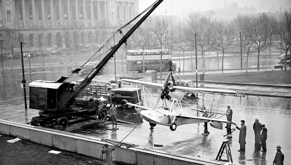 The Budd BB-1 Pioneer Aircraft being placed in front of The Franklin Institute in 1935