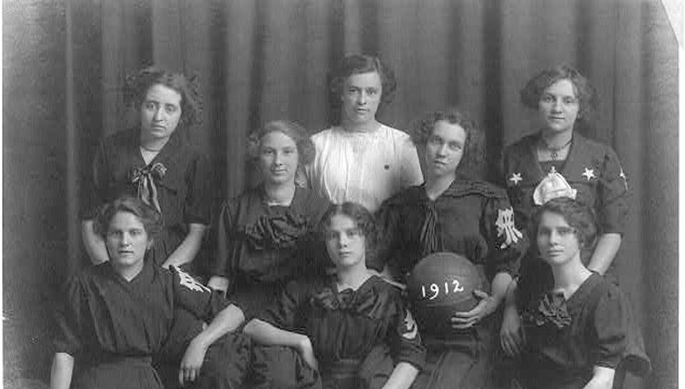 Woman's basketball team from 1912 posing.