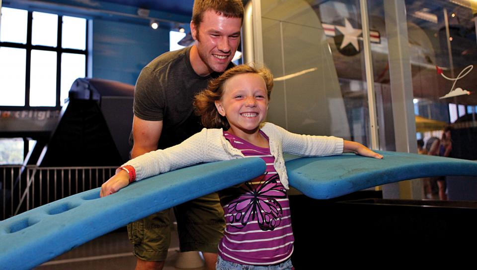 """A young girl experiencing """"lift"""" in The Franklin Airshow."""