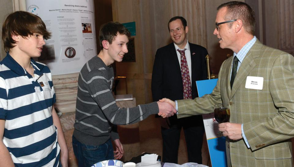 Corporate partners meet some of the students who participate in programs they support.