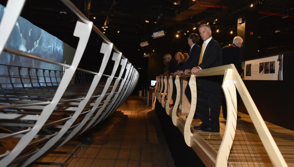 gala guests observing replica Viking ship at The Franklin Institute
